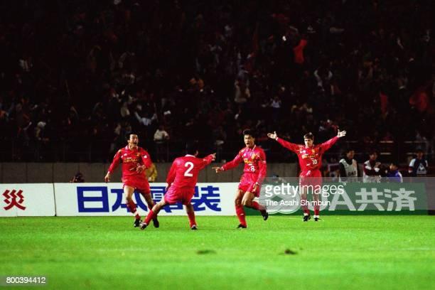 Tetsuya Asano of Nagoya Grampus Eight celebrates scoring his sides first goal with his team mates during the JLeague match between Nagoya Grampus...