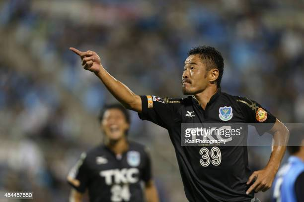 Tetsuya Okubo of Tochigi SC celebrates scoring his team's third goal during the JLeague second division match between Jubilo Iwata and Tochigi SC at...