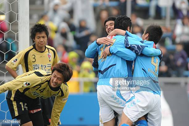 Tetsuya Okubo of Yokohama FC celebrates scoring the second goal with Bae Seung Jin Yutaka Tahara during the JLeague Second Division match between...