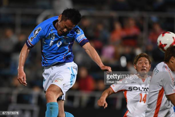 Tetsuya Okubo of Yokohama FC heads the ball to score his side's fourth goal during the JLeague J2 match between Yokohama FC and Ehime FC at Nippatsu...