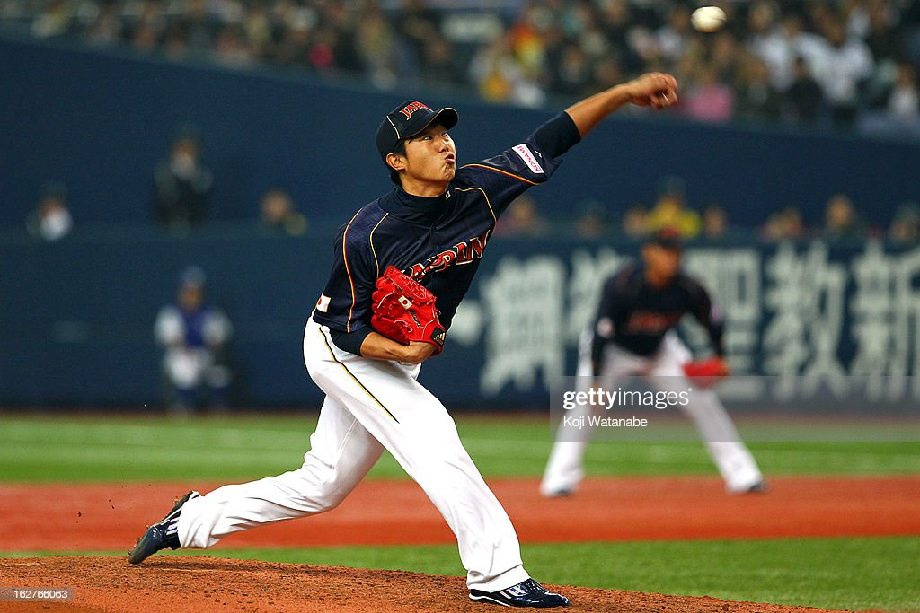 Tetsuya Utsumi #26 of Japan Starting pitcher against Hanshin Tigers in the bottom half of the first inning during the friendly game between Hanshin Tigers and Japan at Kyocera Dome Osaka on February 26, 2013 in Osaka, Japan.