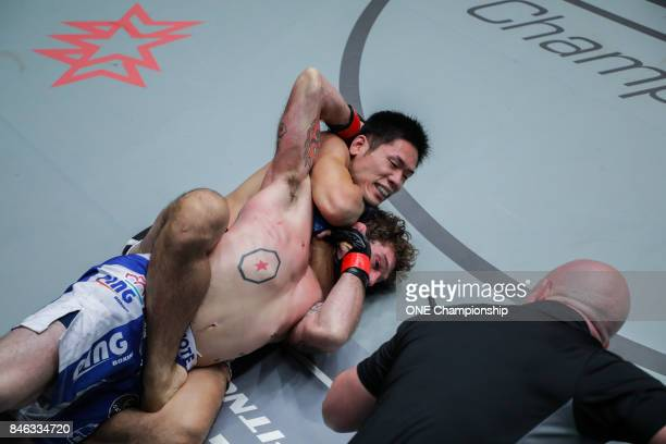 Tetsuya Yamada overpowers Kyle Rozewski for the submission win during ONE Championship Shanghai at the Shanghai Oriental Sports Center on September...