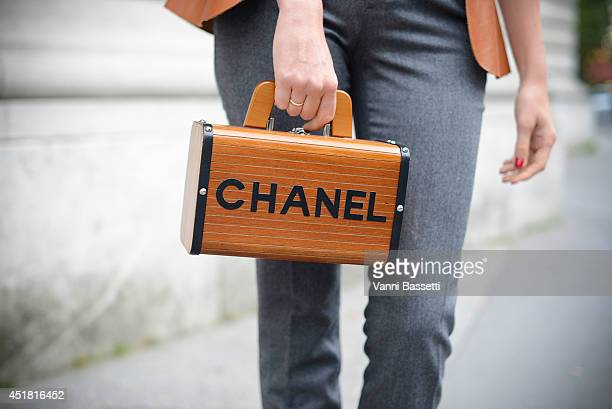 Tetya Motya poses wearing Gucci pants and a vintage Chanel bag before Giambattista Valli show on July 7 2014 in Paris France