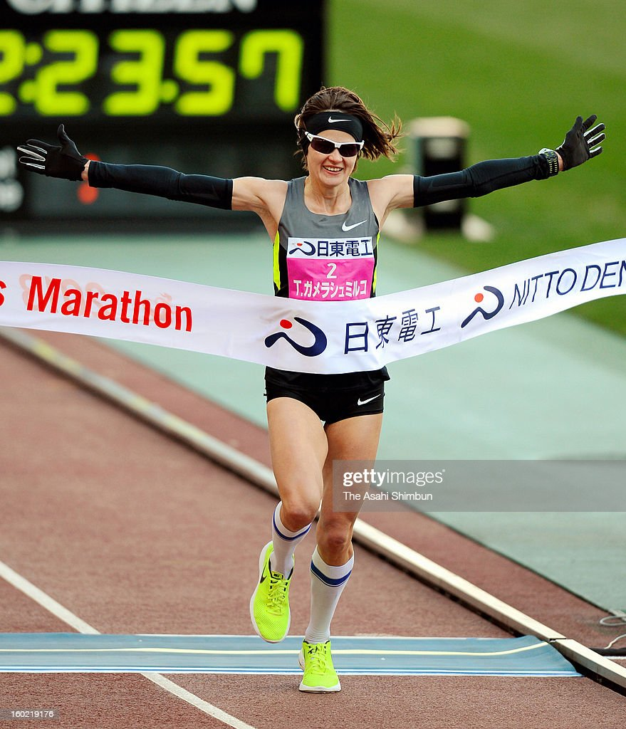 Tetyana Gamera-Shmyrko of Ukraine celebrates winning the 32nd Osaka International Women's Marathon at Nagai Stadium on January 27, 2013 in Osaka, Japan.