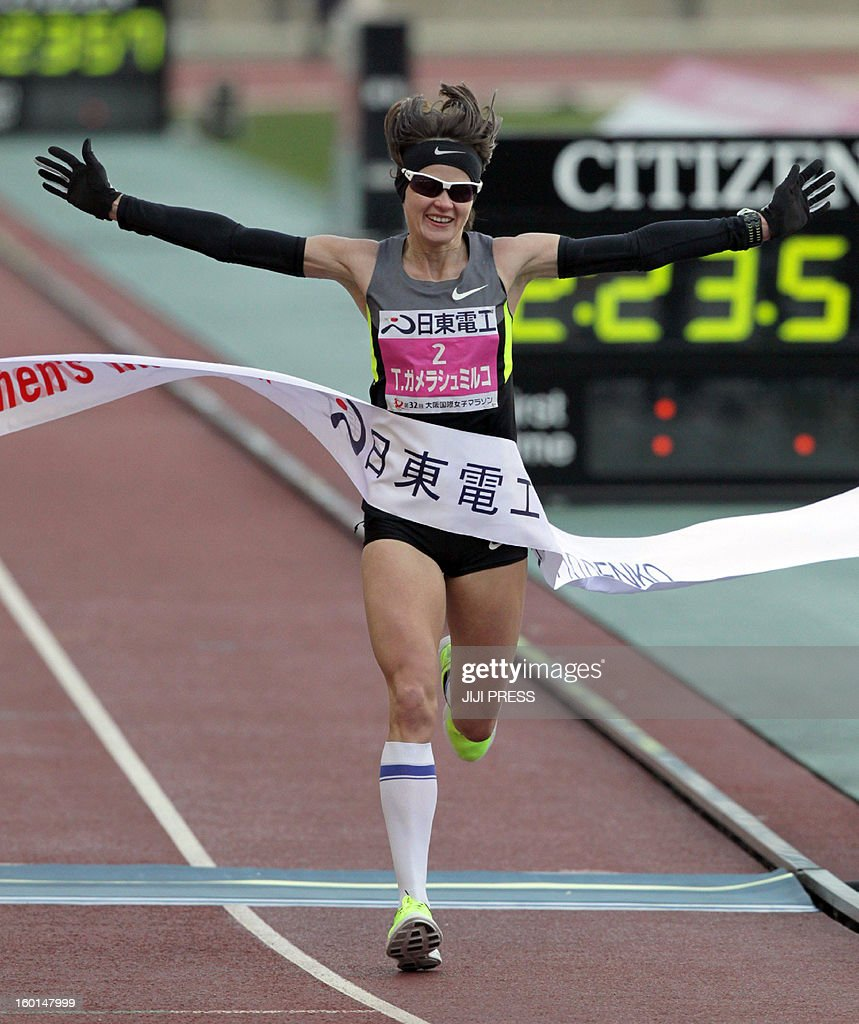 Tetyana Gamera-Shmyrko of Ukraine crosses the finish line of the Osaka international women's marathon at the Nagai stadium in Osaka on January 27, 2013. Gamera-Shmyrko won the race with a time of 2 hours 23 minutes 58 seconds, while Japan's Kayoko Fukushi finished in second. JAPAN