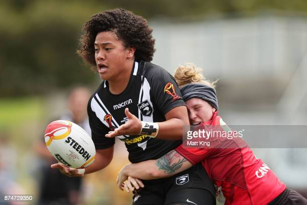 Teuila FotuMoala of New Zealand offloads the ball in a tackle during the 2017 Women's Rugby League World Cup match between New Zealand and Canada at...