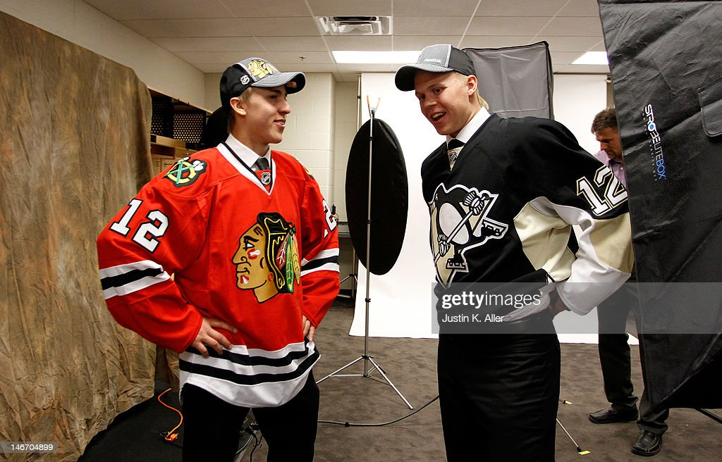 Teuvo Teravainen (L), 18th overall pick by the Chicago Blackhawks, and Olli Maatta, 22nd overall pick by the Pittsburgh Penguins, speak during Round One of the 2012 NHL Entry Draft at Consol Energy Center on June 22, 2012 in Pittsburgh, Pennsylvania.