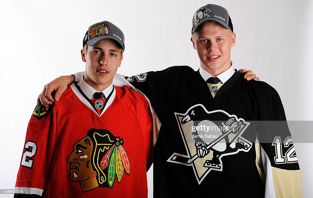 Teuvo Teravainen (L), 18th overall pick by the Chicago Blackhawks, and Olli Maatta (R), 22nd overall pick by the Pittsburgh Penguins, pose for a portrait during Round One of the 2012 NHL Entry Draft at Consol Energy Center on June 22, 2012 in Pittsburgh, Pennsylvania.