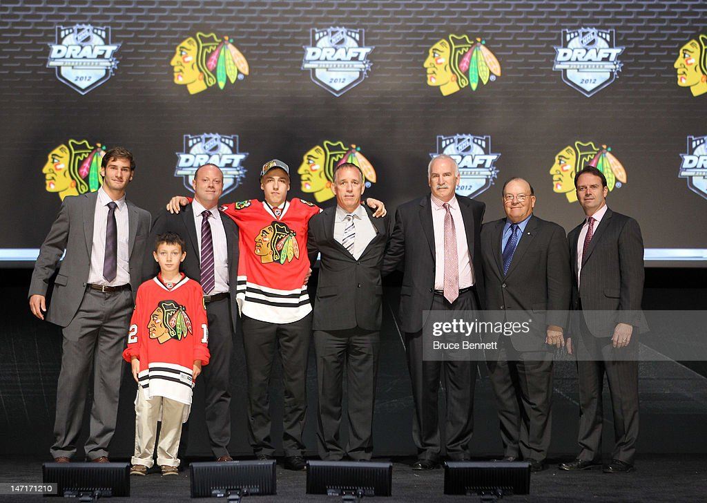 Teuvo Teravainen (4th L), 18th overall pick by the Chicago Blackhawks, poses on stage with team representatives during Round One of the 2012 NHL Entry Draft at Consol Energy Center on June 22, 2012 in Pittsburgh, Pennsylvania.