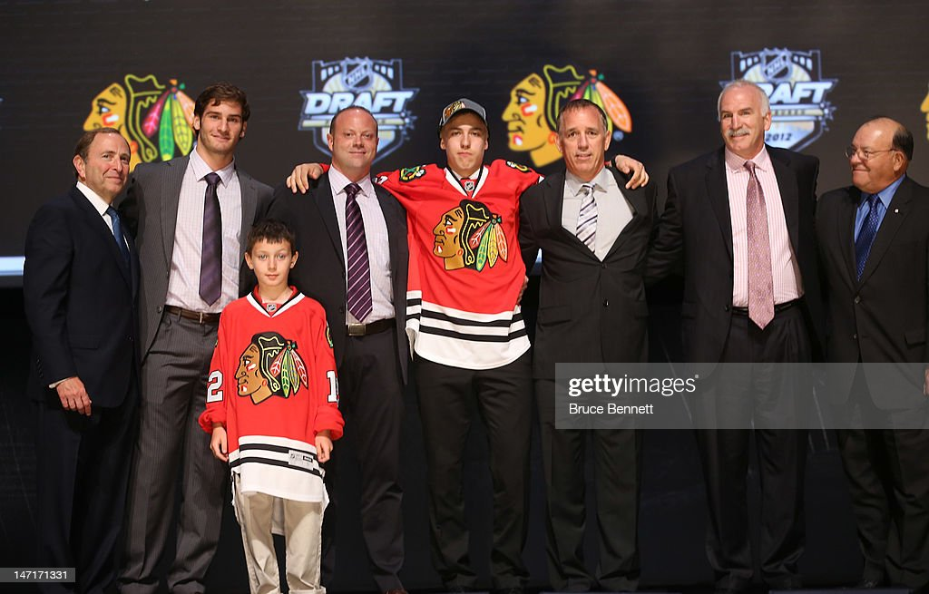 Teuvo Teravainen (4th R), 18th overall pick by the Chicago Blackhawks, poses on stage with NHL Commissioner Gary Bettman (L) and team representatives during Round One of the 2012 NHL Entry Draft at Consol Energy Center on June 22, 2012 in Pittsburgh, Pennsylvania.