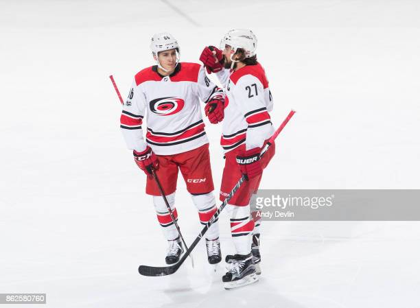 Teuvo Teravainen and Justin Faulk of the Carolina Hurricanes celebrate a goal against the Edmonton Oilers on October 17 2017 at Rogers Place in...