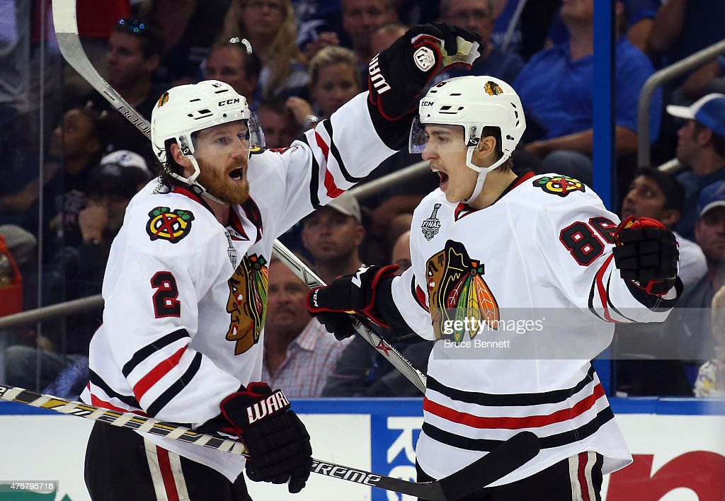 Teuvo Teravainen #86 celebrates his third period goal with <a gi-track='captionPersonalityLinkClicked' href=/galleries/search?phrase=Duncan+Keith&family=editorial&specificpeople=4194433 ng-click='$event.stopPropagation()'>Duncan Keith</a> #2 of the Chicago Blackhawks against the Tampa Bay Lightning during Game One of the 2015 NHL Stanley Cup Final at Amalie Arena on June 3, 2015 in Tampa, Florida.