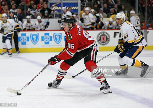 Teuvo Teravainen of the Chicago Blackhawks advances the puck past Mike Ribeiro of the Nashville Predators at the United Center on February 25 2016 in...