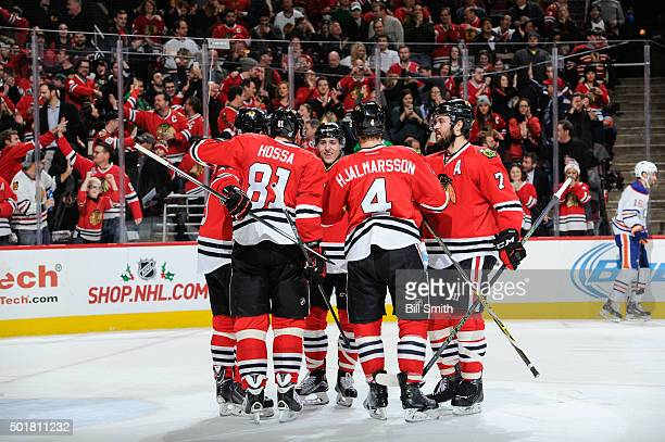Teuvo Teravainen of the Chicago Blackhawks and Brent Seabrook celebrate with teammates after Teravainen scored against the Edmonton Oilers in the...