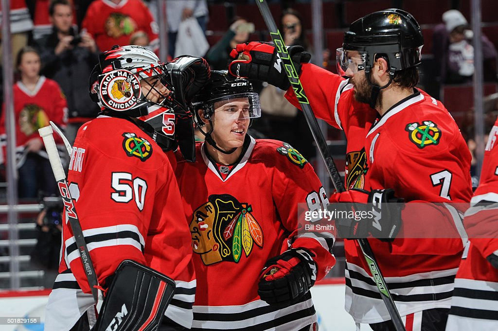 Teuvo Teravainen #86 of the Chicago Blackhawks celebrates with goalie <a gi-track='captionPersonalityLinkClicked' href=/galleries/search?phrase=Corey+Crawford&family=editorial&specificpeople=818935 ng-click='$event.stopPropagation()'>Corey Crawford</a> #50 and <a gi-track='captionPersonalityLinkClicked' href=/galleries/search?phrase=Brent+Seabrook&family=editorial&specificpeople=638862 ng-click='$event.stopPropagation()'>Brent Seabrook</a> #7 after being named the number one player of the game and defeating the Edmonton Oilers 4 to 0 during the NHL game at the United Center on December 17, 2015 in Chicago, Illinois.