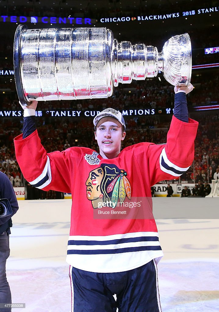 Teuvo Teravainen #86 of the Chicago Blackhawks celebrates with the Stanley Cup after defeating the Tampa Bay Lightning by a score of 2-0 in Game Six to win the 2015 NHL Stanley Cup Final at the United Center on June 15, 2015 in Chicago, Illinois.