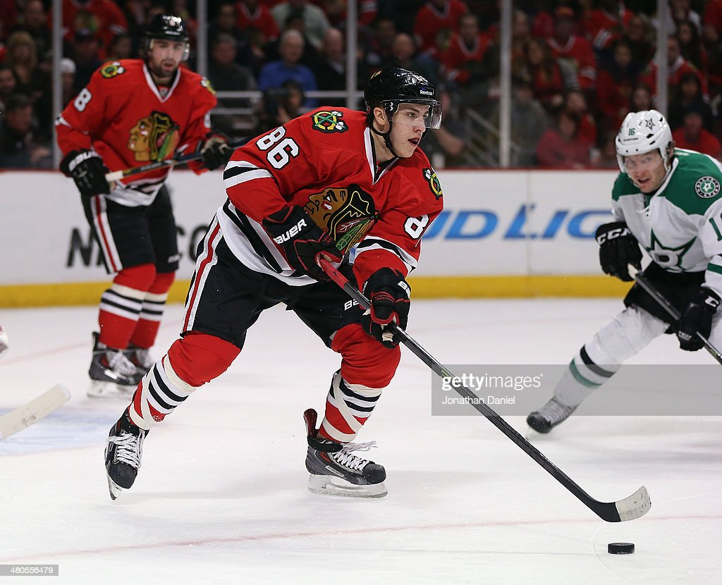 Teuvo Teravainen #86 of the Chicago Blackhawks clears the puck out of the Blackhawks zone past <a gi-track='captionPersonalityLinkClicked' href=/galleries/search?phrase=Ryan+Garbutt&family=editorial&specificpeople=8312174 ng-click='$event.stopPropagation()'>Ryan Garbutt</a> #16 of the Dallas Stars at the United Center on March 25, 2014 in Chicago, Illinois.