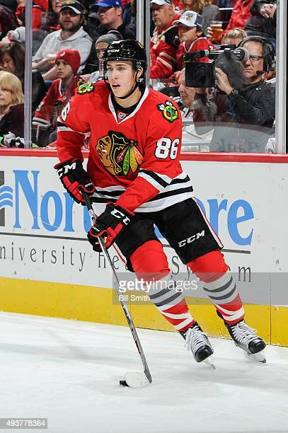 Teuvo Teravainen of the Chicago Blackhawks grabs the puck during the second period of the NHL game against the New York Islanders at the United...