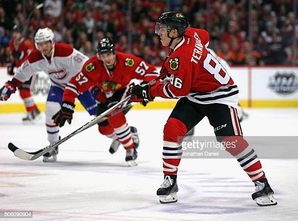 Teuvo Teravainen of the Chicago Blackhawks passes against the Montreal Canadiens at the United Center on January 17 2016 in Chicago Illinois The...