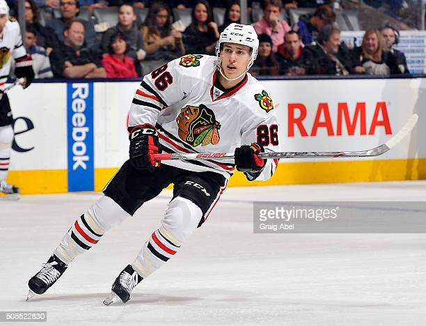 Teuvo Teravainen of the Chicago Blackhawks turns up ice against the Toronto Maple Leafs during game action on January 15 2016 at Air Canada Centre in...