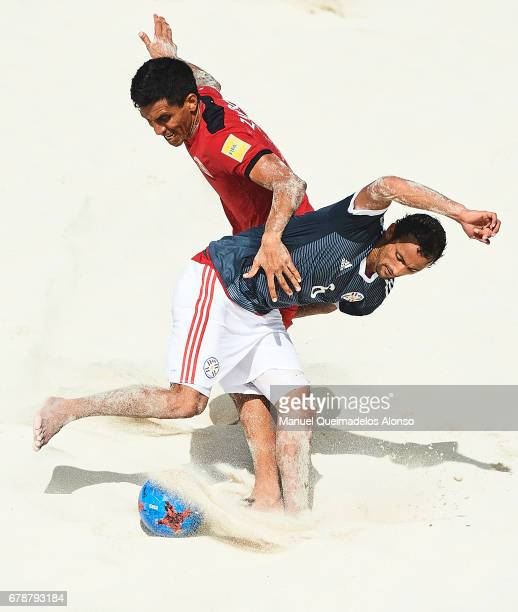 Teva Zaveroni of Tahiti competes for the ball with Pedro Moran of Paraguay during the FIFA Beach Soccer World Cup Bahamas 2017 quarter final match...