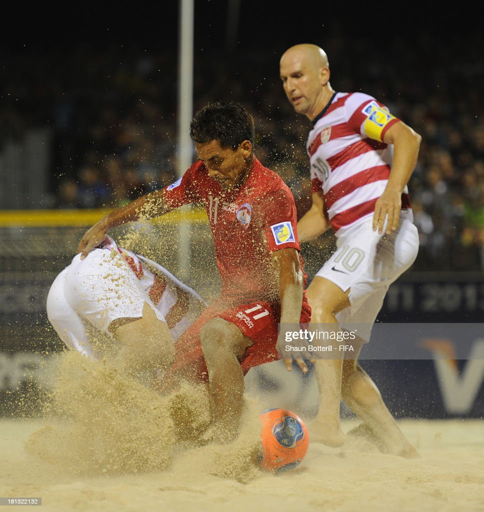 Teva Zaveroni of Tahiti is challenged by Francis Farberoff of USA during the FIFA Beach Soccer World Cup Tahiti 2013 Group A match between USA and Tahiti at the Tahua To'ata stadium on September 21, 2013 in Papeete, French Polynesia.