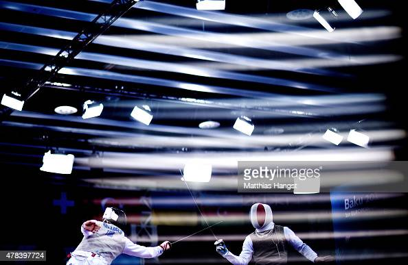 Tevfik Burak Babaoglu of Turkey and Maxime Pauty of France compete in the Men's Fencing Individual Foil Group C match during day thirteen of the Baku...