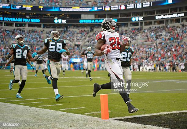 Tevin Coleman of the Atlanta Falcons highsteps into the end zone for a touchdown during fourth quarter of the game against the Carolina Panthers at...