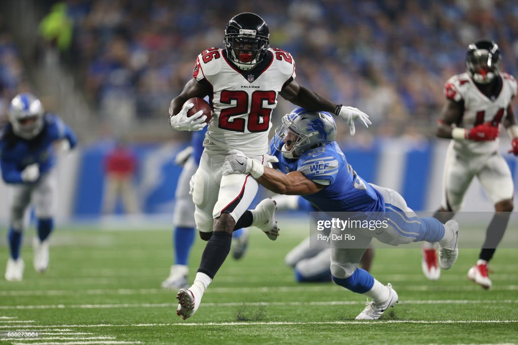 Tevin Coleman #26 of the Atlanta Falcons runs the ball against Miles Killebrew #35 of the Detroit Lions at Ford Field on September 024, 2017 in Detroit, Michigan.