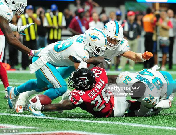 Tevin Coleman of the Atlanta Falcons rushes for a touchdown against the Miami Dolphins at MercedesBenz Stadium on October 15 2017 in Atlanta Georgia