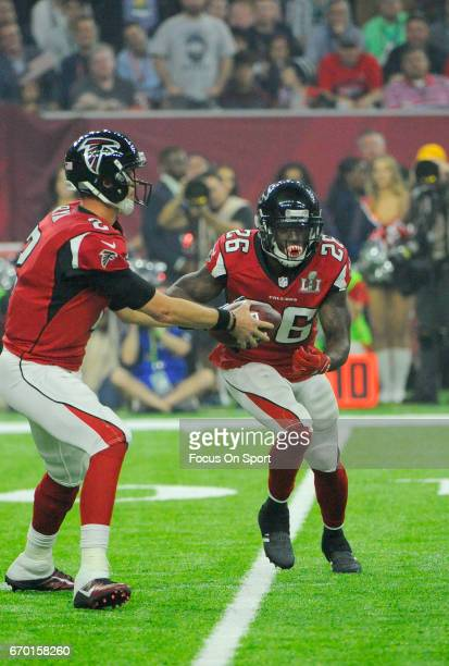 Tevin Coleman of the Atlanta Falcons takes the handoff from Matt Ryan against the New England Patriots during Super Bowl 51 at NRG Stadium on...