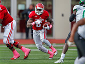 Tevin Coleman of the Indiana Hoosiers looks for running room against the North Texas Mean Green at Memorial Stadium on October 4 2014 in Bloomington...
