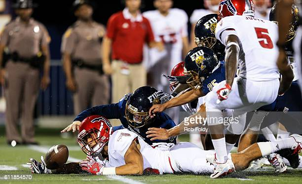 Tevin Homer of the Florida Atlantic Owls recovers a loose ball during the first half of the game against the FIU Panthers at FIU Stadium on October 1...