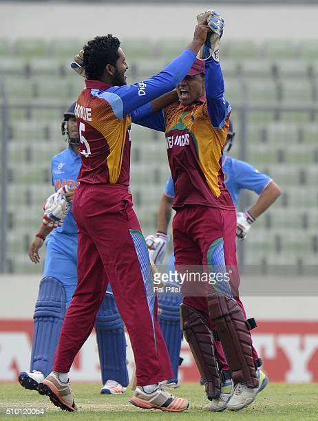 Tevin Imlach of West Indies U19 celebrates the wicket of Rishabh Pant of India with teammate Jyd Goolie of West Indies U19 during the ICC U19 World...