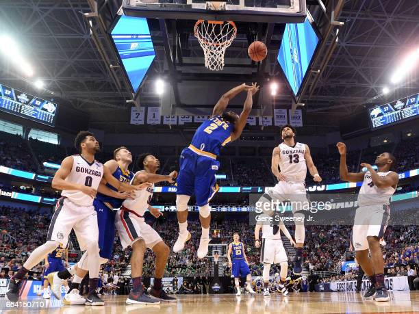 Tevin King of the South Dakota State Jackrabbits drives to the basket against Josh Perkins of the Gonzaga Bulldogs in the first half during the first...