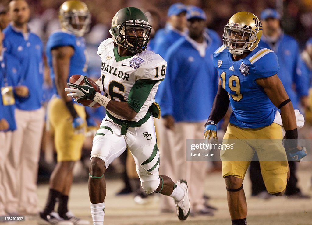 Tevin reese #16 of the Baylor Bears catches the ball ona 55-yard reception scoring a touchdownl in the first half of the game as Zach Hernandez #19 of the UCLA Bruins defends in the Bridgepoint Education Holiday Bowl at Qualcomm Stadium on December 27, 2012 in San Diego, California.
