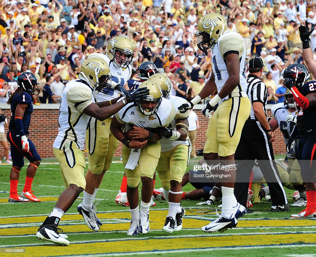 Tevin Washington #40 of the Georgia Tech Yellow Jackets is congratulated by teammates after scoring a touchdown against the Virginia Cavaliers at Bobby Dodd Stadium on September 15, 2012 in Atlanta, Georgia.