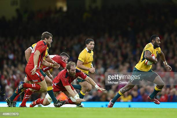 Tevita Kuidrani of Australia breaks through the challenge of Alun Wyn Jones of Wales to score his sides third try during the International match...