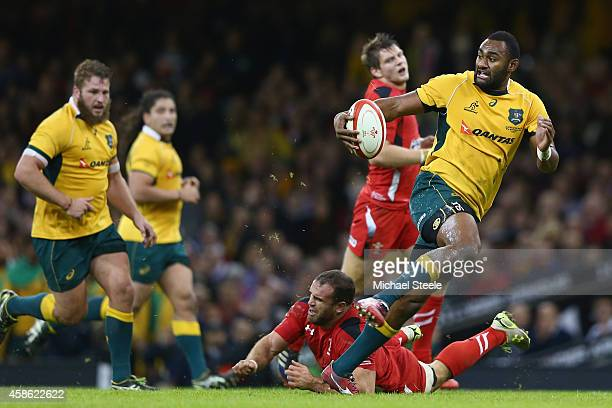 Tevita Kuidrani of Australia breaks through the challenge of Jamie Roberts of Wales to score his sides third try during the International match...