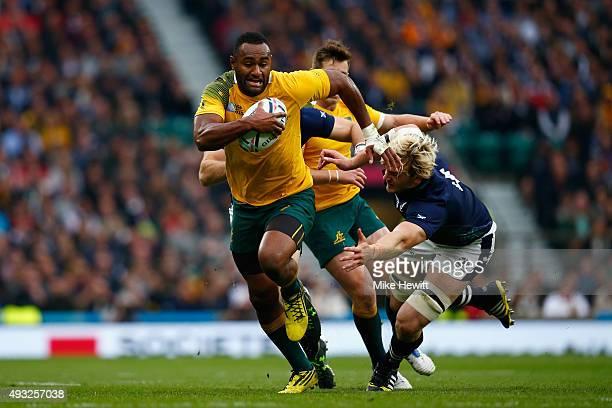 Tevita Kuridrani of Australia breaks past Richie Gray of Scotland during the 2015 Rugby World Cup Quarter Final match between Australia and Scotland...