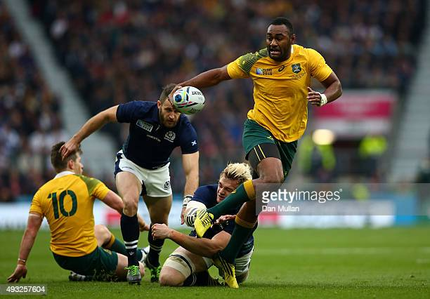 Tevita Kuridrani of Australia breaks through the tackle from Richie Gray of Scotland during the 2015 Rugby World Cup Quarter Final match between...