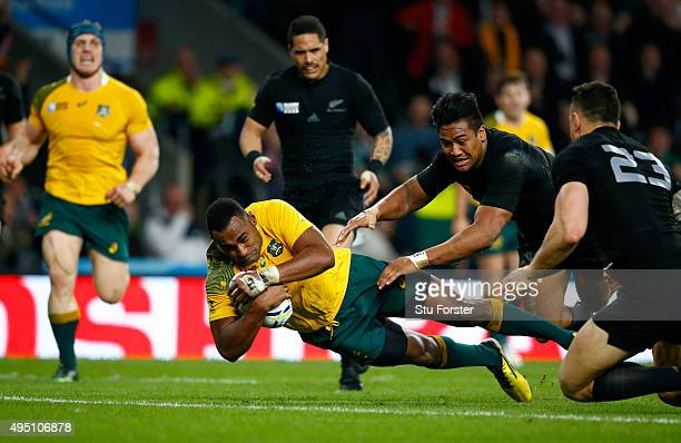 Tevita Kuridrani of Australia dives over the line to score his team's second try during the 2015 Rugby World Cup Final match between New Zealand and...