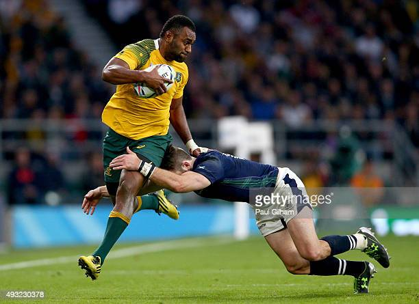 Tevita Kuridrani of Australia is tackled by Tommy Seymour of Scotland during the 2015 Rugby World Cup Quarter Final match between Australia and...