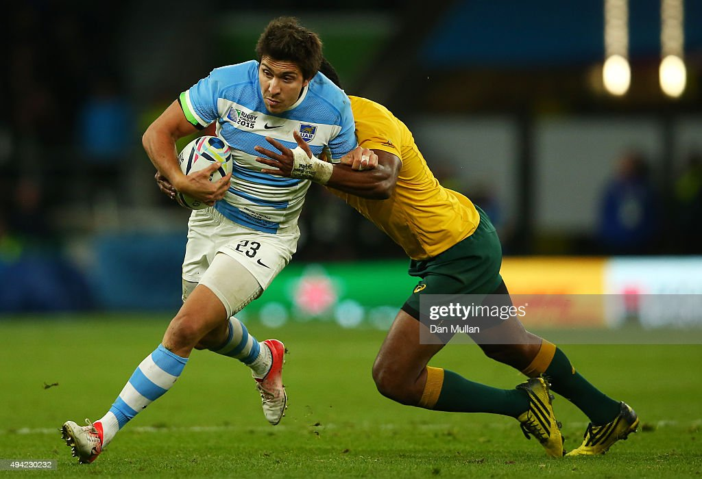 <a gi-track='captionPersonalityLinkClicked' href=/galleries/search?phrase=Tevita+Kuridrani&family=editorial&specificpeople=7612194 ng-click='$event.stopPropagation()'>Tevita Kuridrani</a> of Australia tackles Lucas Gonzalez Amorosino of Argentina during the 2015 Rugby World Cup Semi Final match between Argentina and Australia at Twickenham Stadium on October 25, 2015 in London, United Kingdom.