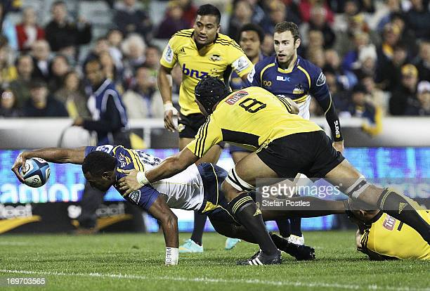 Tevita Kuridrani of the Brumbies attempts to score a try during the round 16 Super Rugby match between the Brumbies and the Hurricanes at Canberra...