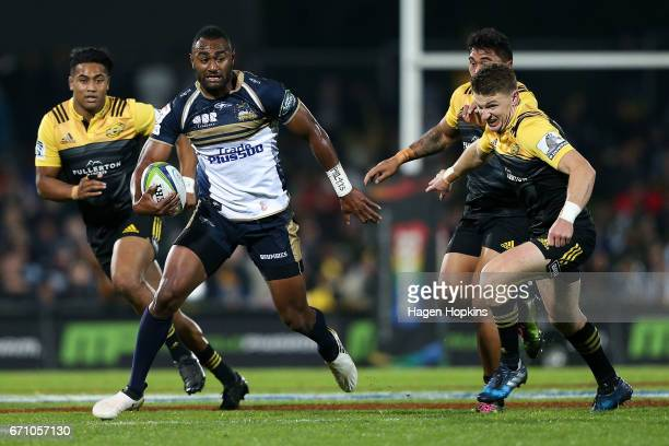 Tevita Kuridrani of the Brumbies beats the challenge of Beauden Barrett of the Hurricanes during the round nine Super Rugby match between the...