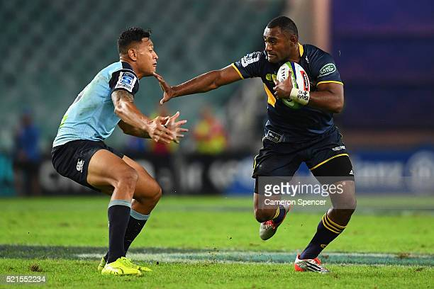Tevita Kuridrani of the Brumbies fends off Israel Folau of the Waratahs during the round eight Super Rugby match between the Waratahs and the...