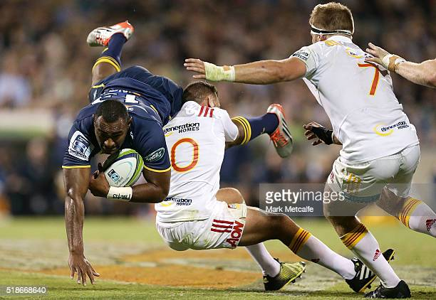 Tevita Kuridrani of the Brumbies is tackled by Aaron Cruden of the Chiefs during the round six Super Rugby match between the Brumbies and the Chiefs...