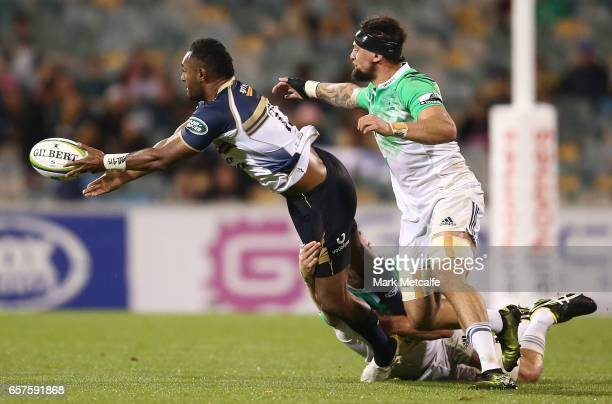 Tevita Kuridrani of the Brumbies offloads during the round five Super Rugby match between the Brumbies and the Highlanders at GIO Stadium on March 25...