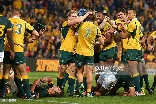 Tevita Kuridrani of the Wallabies celebrates with team mates after scoring the winning try during The Rugby Championship match between the Australian...